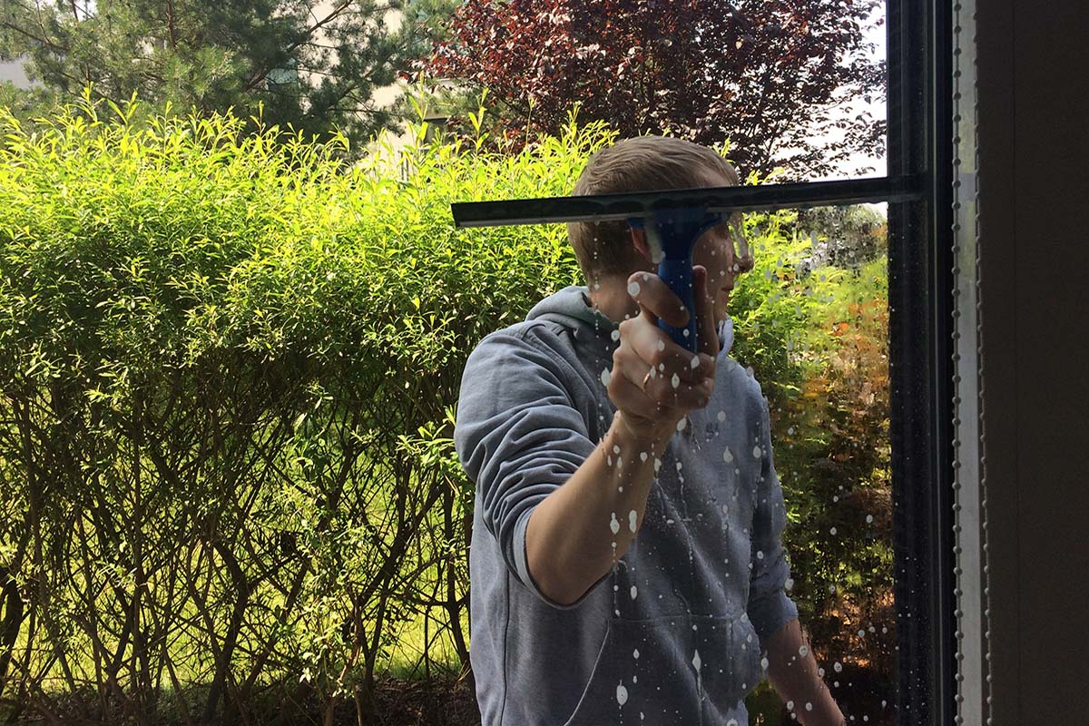 man working residential window cleaning in florida